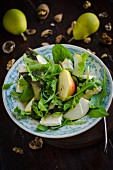 An autumnal salad with brie, walnuts, lettuce and pears