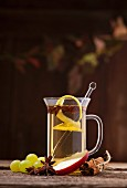 White mulled wine with lemon zest and apple
