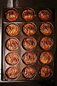 Apple tarts in baking tins