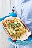 Courgette and ham lasagne with nuts and parsley