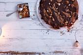 Honey cake with chopped nuts and chocolate glaze