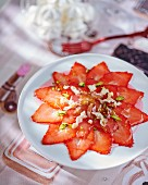 Strawberry carpaccio with dates, pistachios and nougat