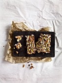 Homemade chocolate bars with pretzel sticks and pistachios