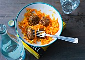 Carrot salad with apple and meatballs