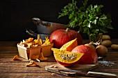 An autumnal arrangement featuring pumpkins, chanterelle mushrooms, onions, potatoes, parsley and salt