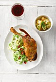 Glazed goose legs with pointed cabbage, chilli peppers, rosehip sauce and a side of potatoes