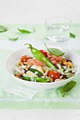 Sauteed mange tout and fava beans with cherry tomatoes and Prosciutto