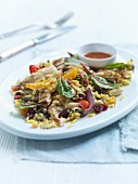 Mediterranean chicken salad with roast vegetables, olives and beans