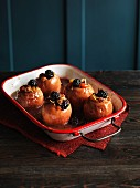 Baked apples with fruit and nuts in a baking dish