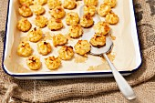Duchesse potatoes on a baking tray