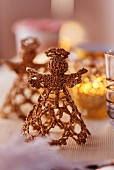 Crocheted, gold angels decorating table for Christmas (close-up)