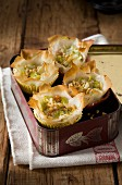 Mini leek and almond puff pastry tartlets in a tin