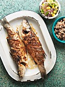 Sea bass with bean rice and pineapple salsa
