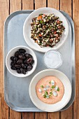 Greek mezze: taramasalata, olives and tabbouleh