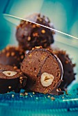 Chocolate and nut pralines with brittle and hazelnuts (cross-section)