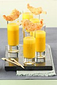 Orange and pumpkin soup shots with scampi