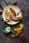 Green bananas fried in their skins with tahini and cocoa butter sprinkled with coconut flakes