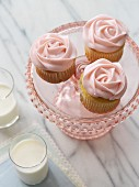 Rose cupcakes and two glasses of milk