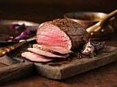 Chateaubriand, sliced on a wooden board