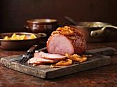 Glazed roast ham with oranges