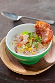 Sweetcorn soup with ham, prawns and parsley