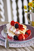 A pancake filled with vanilla cream and mixed berries