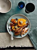 Turkey leg with mashed sweet potatoes and oven-roasted vegetables