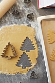 Christmas trees cut out of shortbread pastry with a cutter