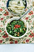 Chard with peanuts and onions