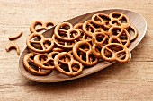 Salted pretzels in a wooden dish