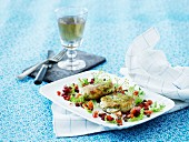 Fish cakes with dill, beetroot, peppers and lettuce
