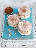 Coffee meringue with cream and cocoa powder