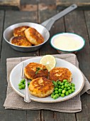 Potato and smoked mackerel cakes with peas and lime mayonnaise