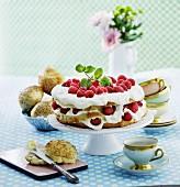 Raspberry cake with vanilla quark cream on a cake stand