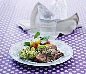 Boiled beef with dill potatoes and a colourful tomato salad