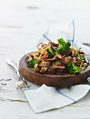 Fried mushrooms with noodles and broccoli