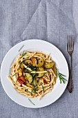 Strozzapreti with a tomato and courgette medley and rosemary