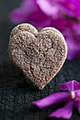 Heart-shaped chocolate and almond biscuits with sugar