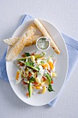 Egg salad with vegetables, blue cheese dressing and toast