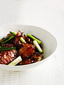 Fish in a honey and chilli marinade with spring onions