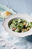 Rocket and ricotta gnocchi with almonds