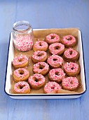 Mini doughnuts with pink glaze and sprinkles