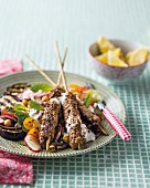 Oriental spiced minced beef skewers with a side of vegetables