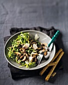 Marinated mushrooms with rocket and Parmesan cheese