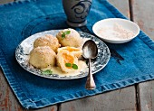Sweet dumplings with yellow plum jam