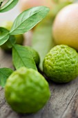 Keffir limes on a wooden board