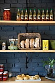 Bread, preserves and savoury pastries on pantry shelves