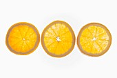 Orange slices on a white surface