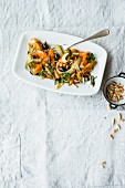 Carrots à la Provence with black olives and pine nuts