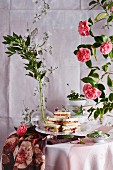 Classic tea time sandwiches with smoked trout, cucumber, apple and organic carnations